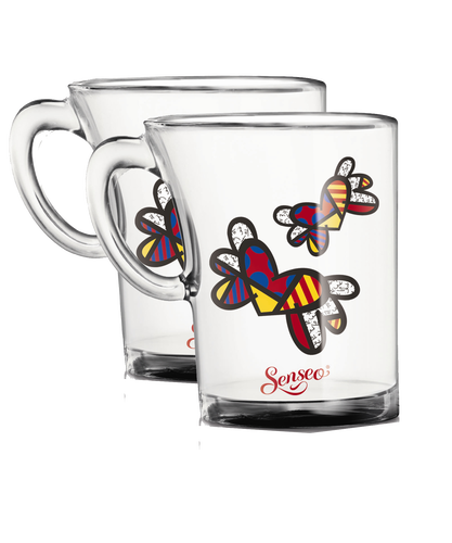 lot de 2 tasses edition limit e romero britto senseo. Black Bedroom Furniture Sets. Home Design Ideas